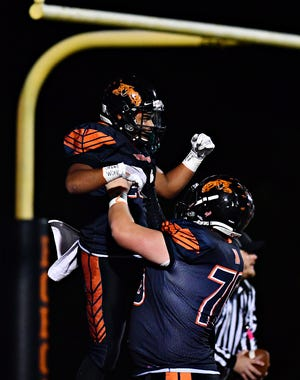 Northeastern players celebrate during a game earlier this season. The Bobcats hope to celebrate again after Friday's District 3 Class 5-A playoff game at Shippensburg. YORK DISPATCH FILE PHOTO