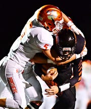 Central York's Beau Pribula is shown here making a tackle as a safety last season for the Panthers. The rising sophomore is expected to be the Panthers' starting quarterback this season, succeeding his brother, Cade.