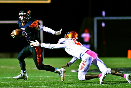 Northeastern's Jordan Lagana, left, works to get around Central York's Saahir Cornelius during football action at Northeastern Senior High School in Manchester, Friday, Oct. 12, 2018. Central York would win the game 44-7. Dawn J. Sagert photo