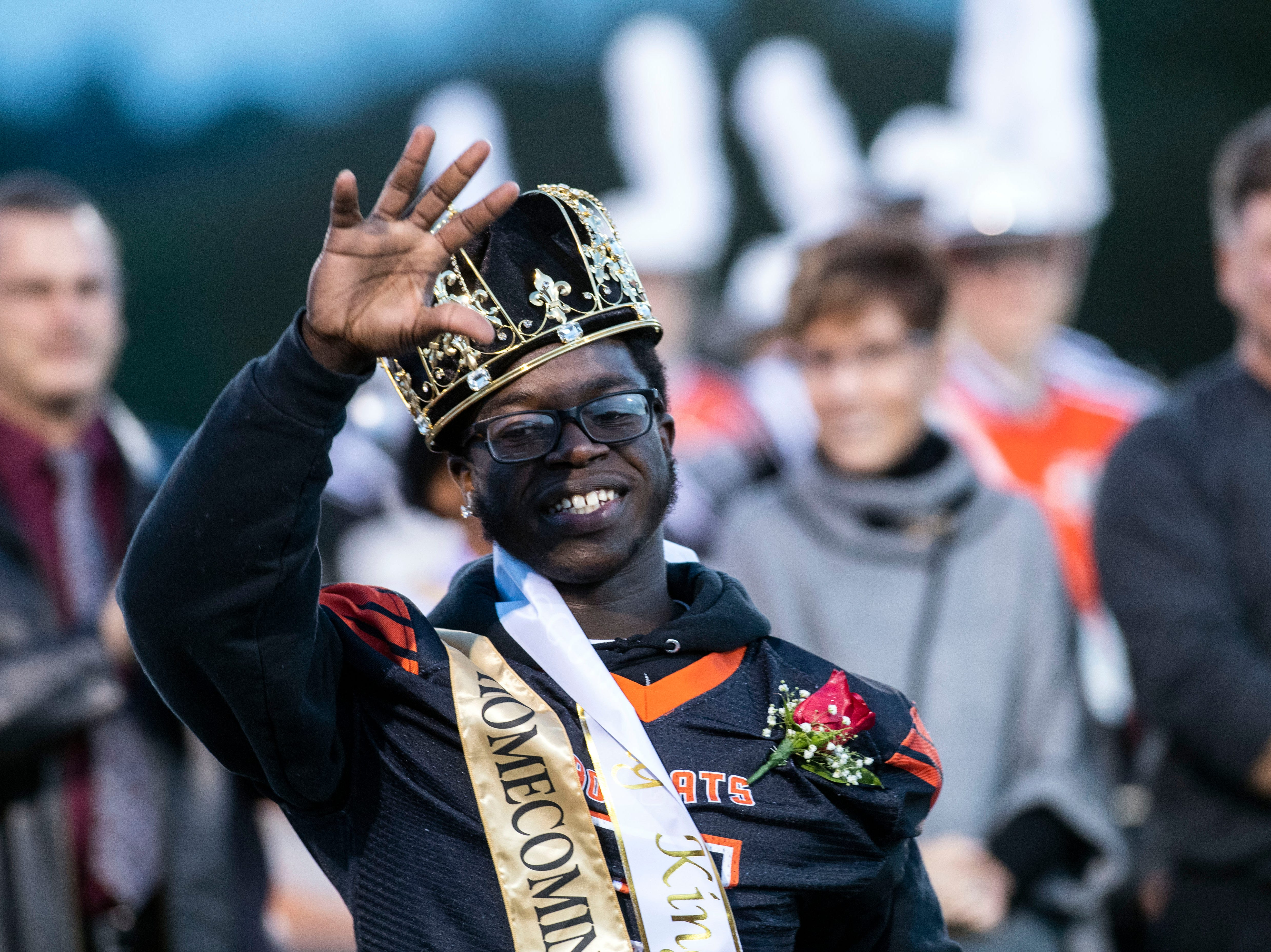 Frank Brown waves to the crowd after winning homecoming king prior to a YAIAA Division I football game at Northeastern High School on Friday, Oct. 12, 2018. The Central York Panthers beat the Northeastern Bobcats, 44-7.