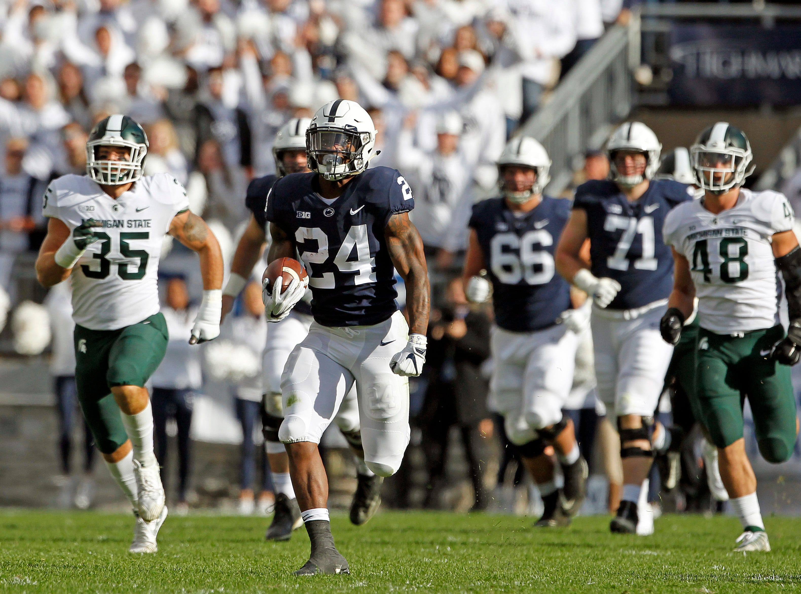 Penn State's Miles sanders (24) breaks off a long run against Michigan State during the first half of an NCAA college football game in State College, Pa., Saturday, Oct. 13, 2018.