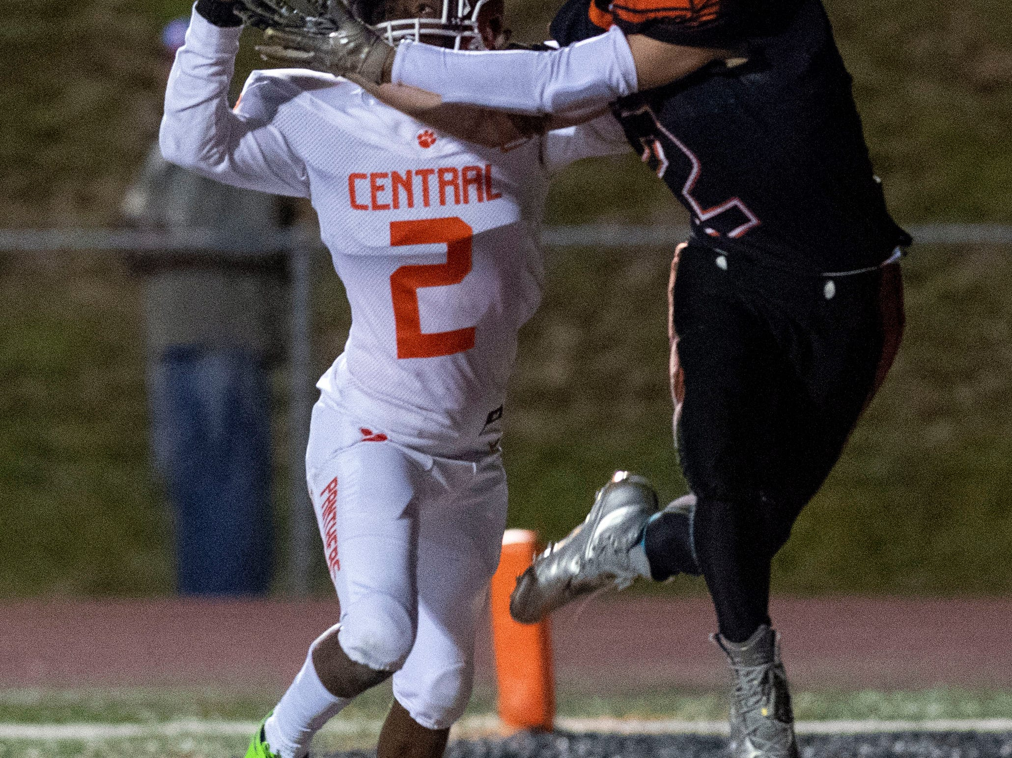 Central York's Darnell Johnson (2) knocks the ball out of reach for intended receiver Jordan Lagana (2) during a YAIAA Division I football game at Northeastern High School on Friday, Oct. 12, 2018. The Central York Panthers beat the Northeastern Bobcats, 44-7.