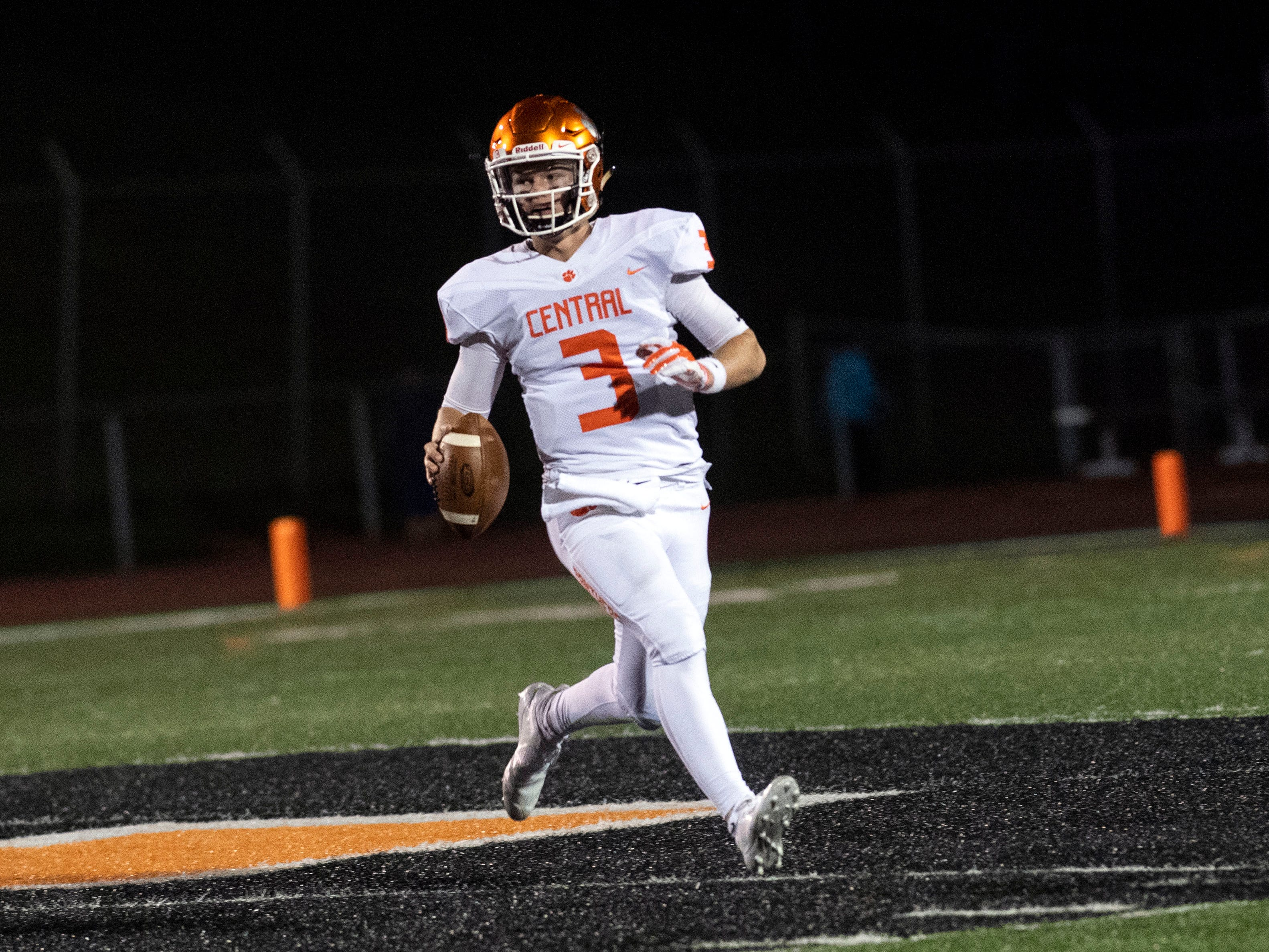 Central York quarterback Cade Pribula (3) runs toward the sidelines while eyeing up a receiver during a YAIAA Division I football game at Northeastern High School on Friday, Oct. 12, 2018. The Central York Panthers beat the Northeastern Bobcats, 44-7.