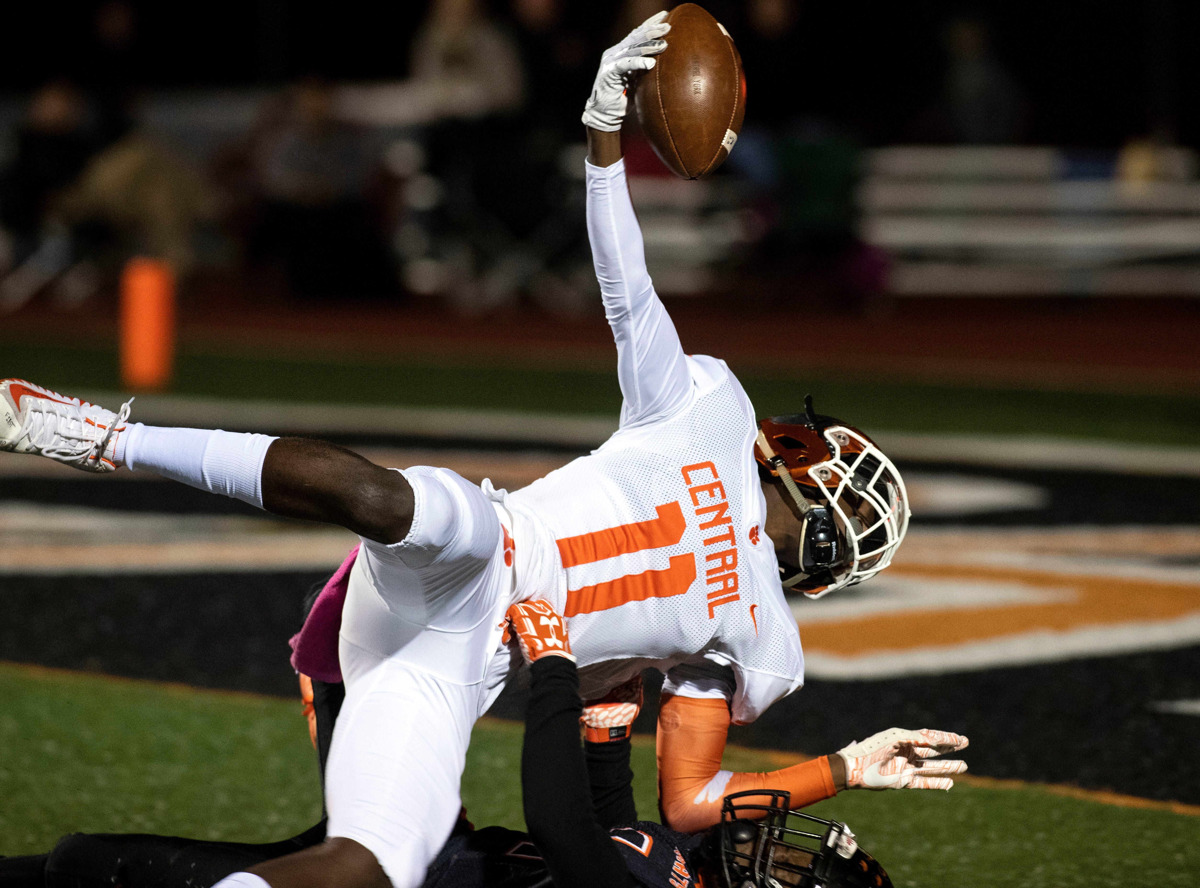 Central York's Taylor Wright-Rawls (11) tries to reach the ball into the endzone after being tackled by Northeastern's Dashon Brown (1) during a YAIAA Division I football game at Northeastern High School on Friday, Oct. 12, 2018. The Central York Panthers beat the Northeastern Bobcats, 44-7.
