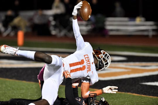 Central York's Taylor Wright-Rawls is tackled after a 52-yard catch against Northeastern on Friday. Central York won, 44-7.