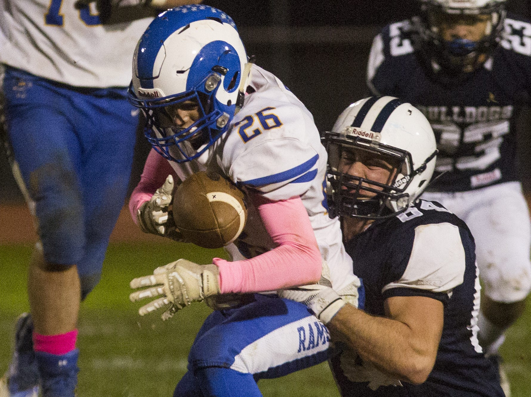 Kennard-Dale's Josh Vipperman, left, is tackled by West York's Austin Coy. West York defeats Kennard-Dale 32-21 in football at West York Area High School in West York, Friday, October 12, 2018.