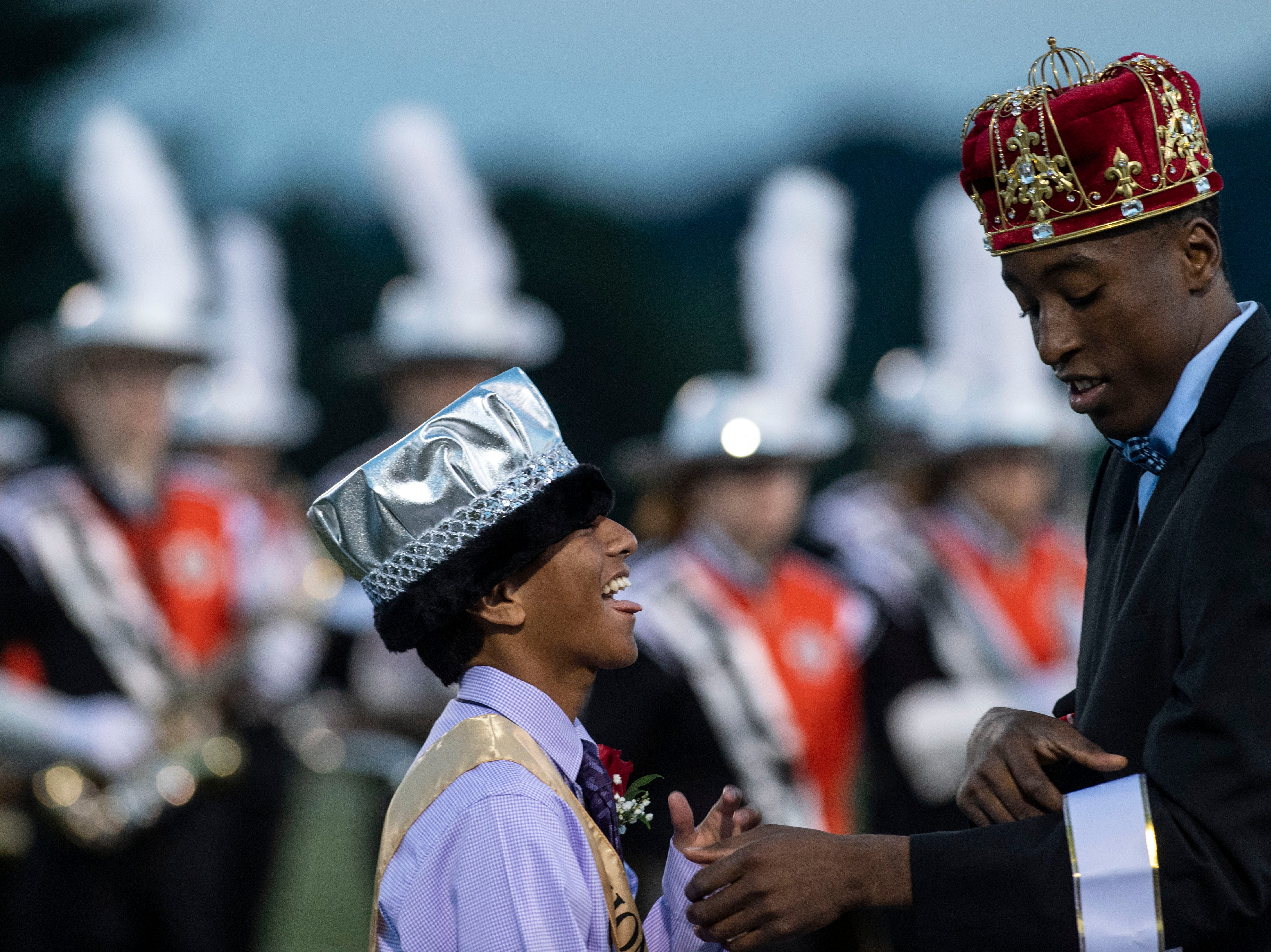 The 2017 Northeastern homecoming king, right, crowns this year's homecoming prince prior to a YAIAA Division I football game at Northeastern High School on Friday, Oct. 12, 2018. The Central York Panthers beat the Northeastern Bobcats, 44-7.