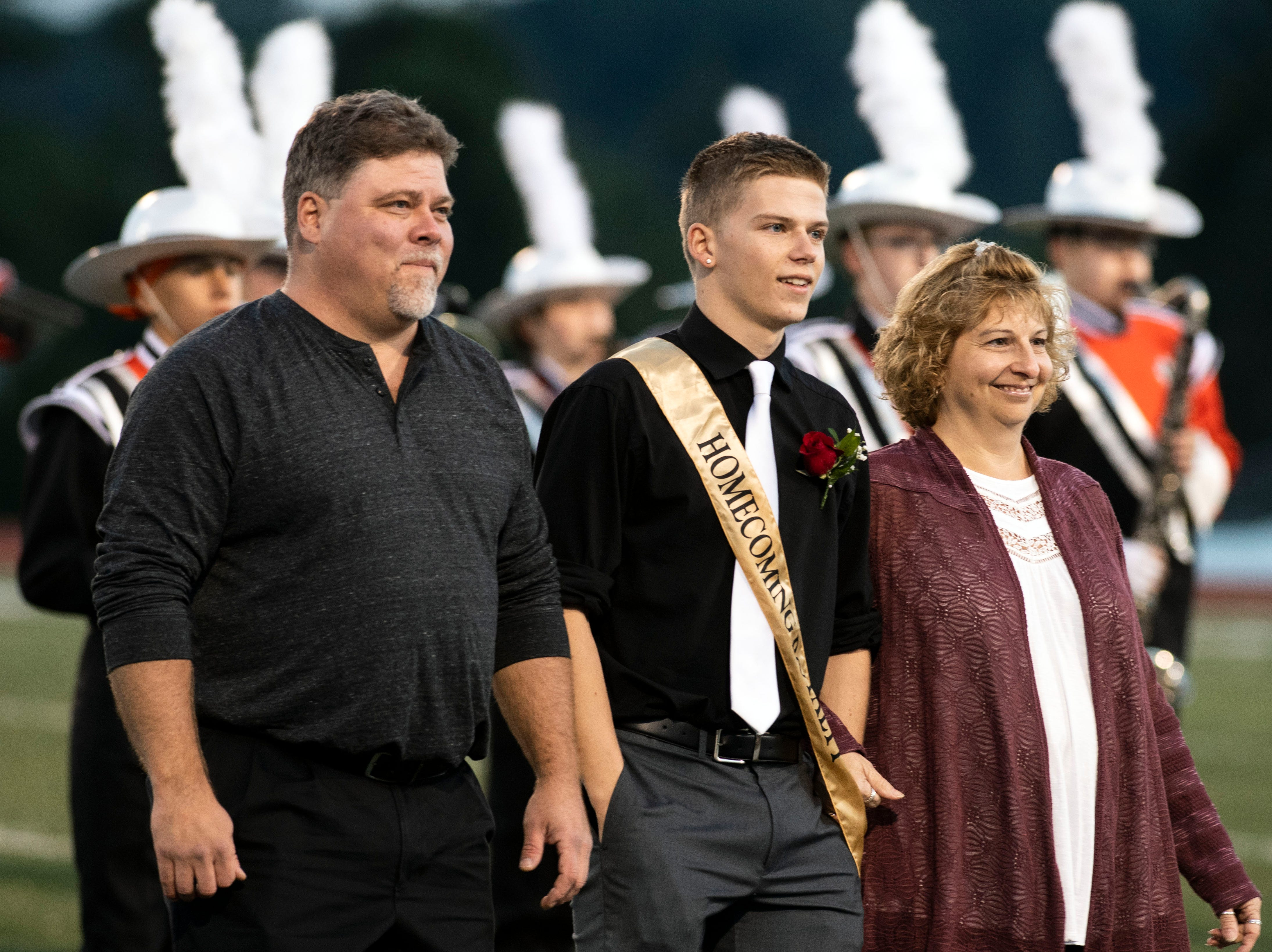Members of Northeastern's homecoming court are escorted down the 50-yard line prior to a YAIAA Division I football game at Northeastern High School on Friday, Oct. 12, 2018. The Central York Panthers beat the Northeastern Bobcats, 44-7.