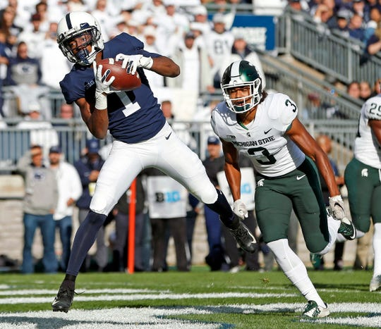 Penn State's KJ Hamler (1) catches a touchdown pass in front of Michigan State's Xavier Henderson (3) during the first half of an NCAA college football game in State College, Pa., Saturday, Oct. 13, 2018.