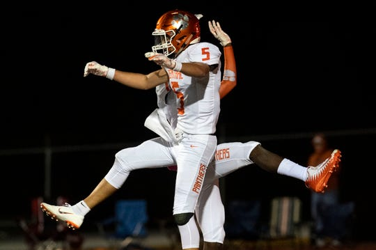 Central York's Beau Pribula (5) celebrates with a teammate after scoring a touchdown during a YAIAA Division I football game at Northeastern High School on Friday, Oct. 12, 2018. The Central York Panthers beat the Northeastern Bobcats, 44-7.