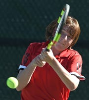 Reno's Jeff Rinehart hits backhand to opponent Frank Little of Spanish Springs during the 2018 NIAA 4A Northern Region Tennis Championships on Friday Oct. 12, 2018.