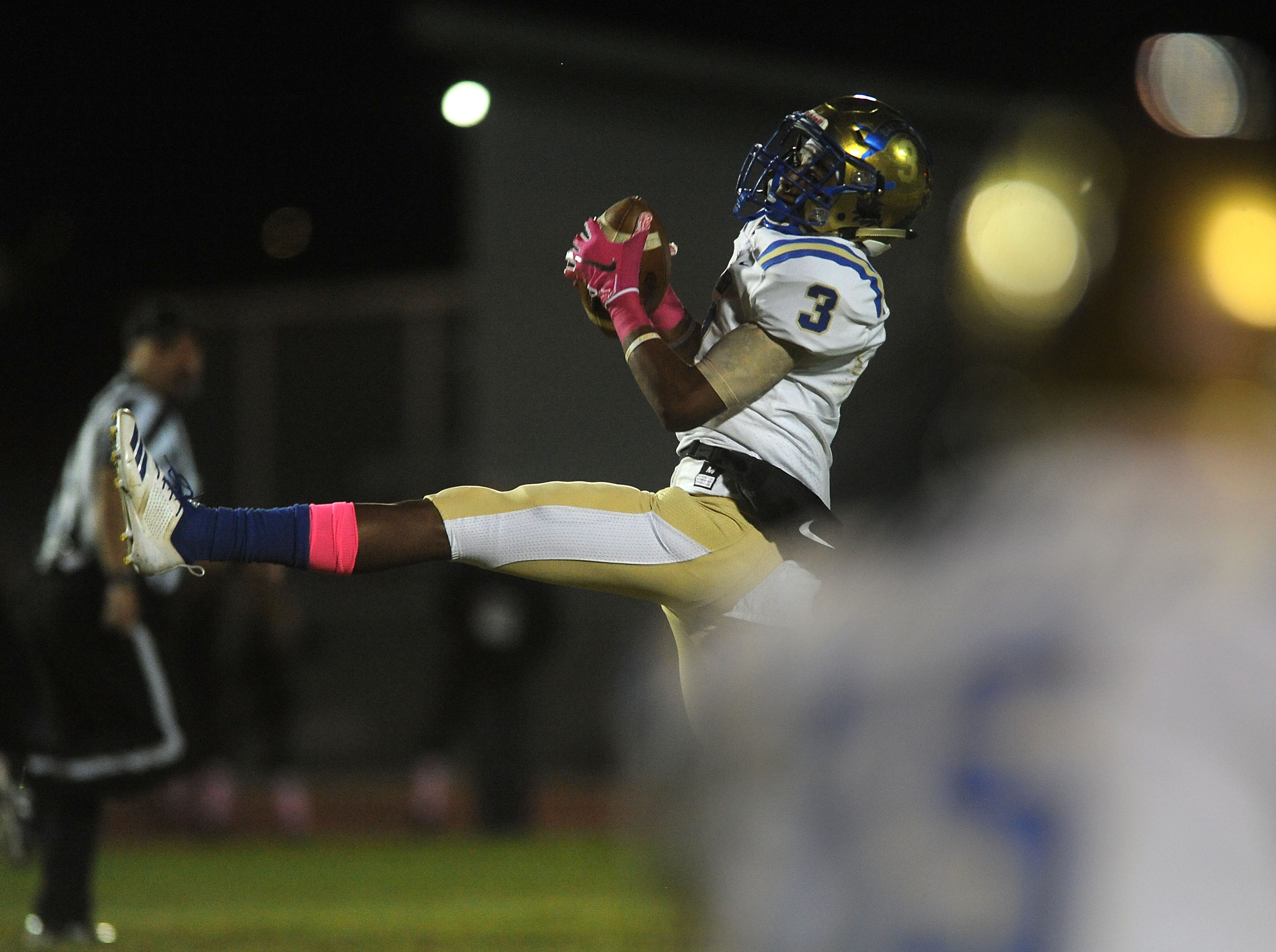 Reed's Demarea Johnson-Cooper (3) makes a catch while taking on Reno during their football game at Reno on Oct. 12, 2018.