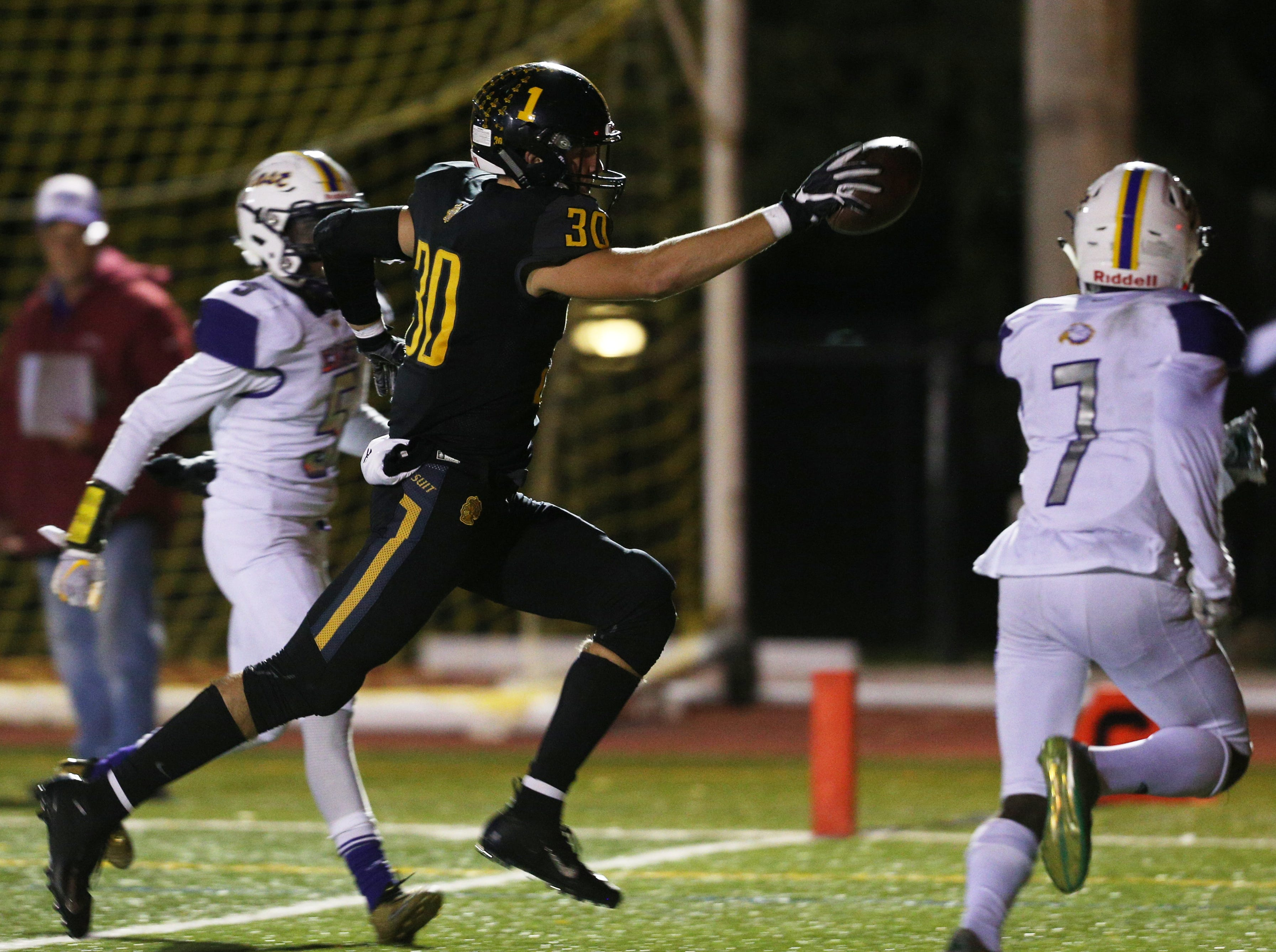 McQuaid's Connor Zamiara runs in for a touchdown against East.