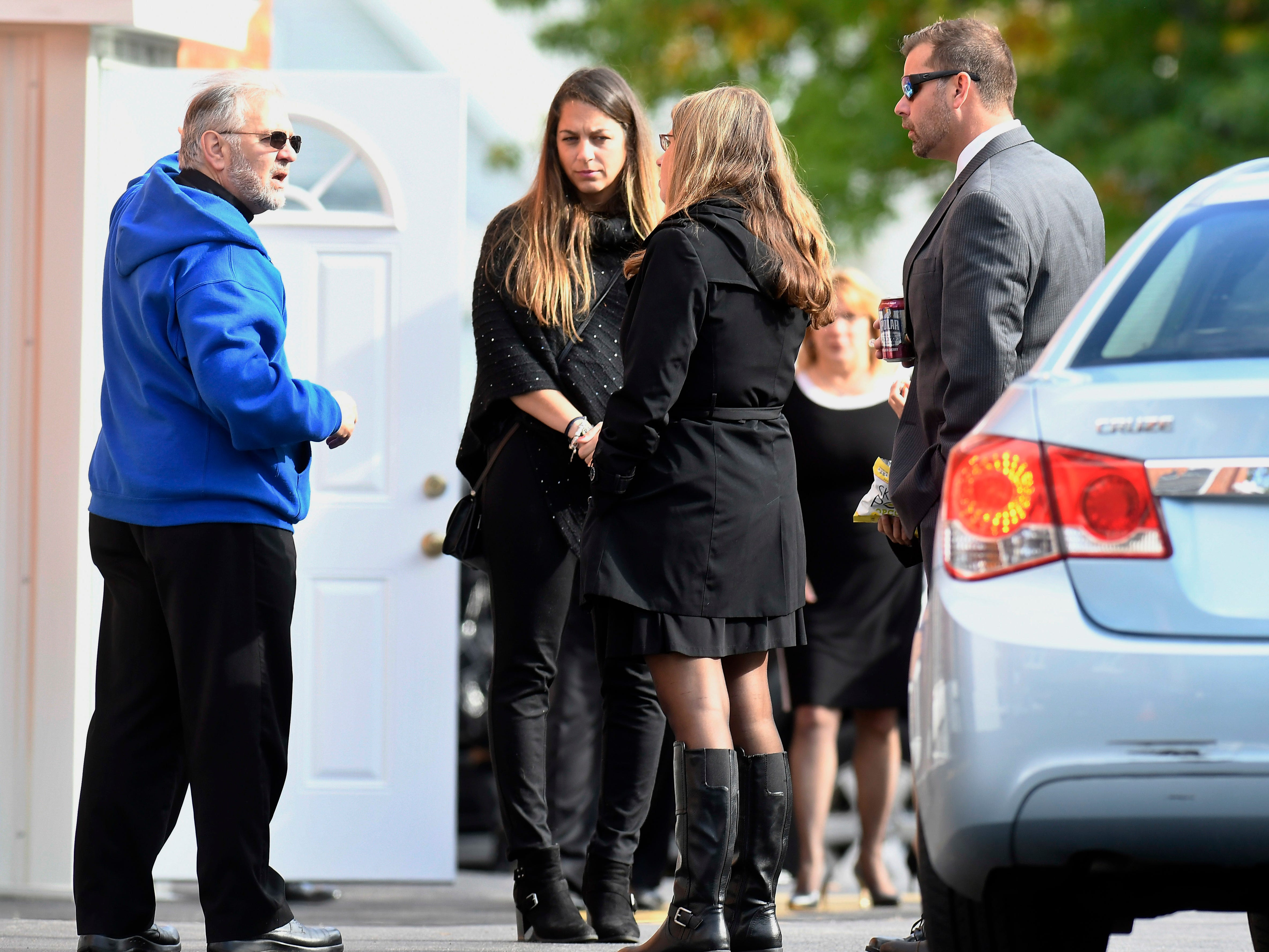 Friends and family attend a funeral mass for eight of the 20 people killed in last Saturday's fatal limousine crash in Schoharie, N.Y., during a memorial service at St. Stanislaus Roman Catholic Church in Amsterdam, N.Y., Saturday, Oct. 13, 2018. (AP Photo/Hans Pennink)