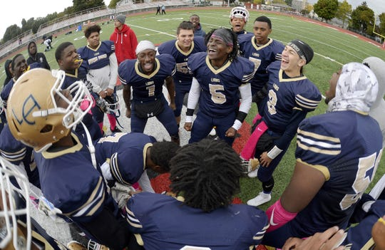 Leadership Academy players celebrate their win over Bishop Kearney/Rochester Prep during a regular season game played at Franklin High School, Saturday, Oct. 13, 2018. Leadership Academy beat Bishop Kearney/Rochester Prep 12-6.