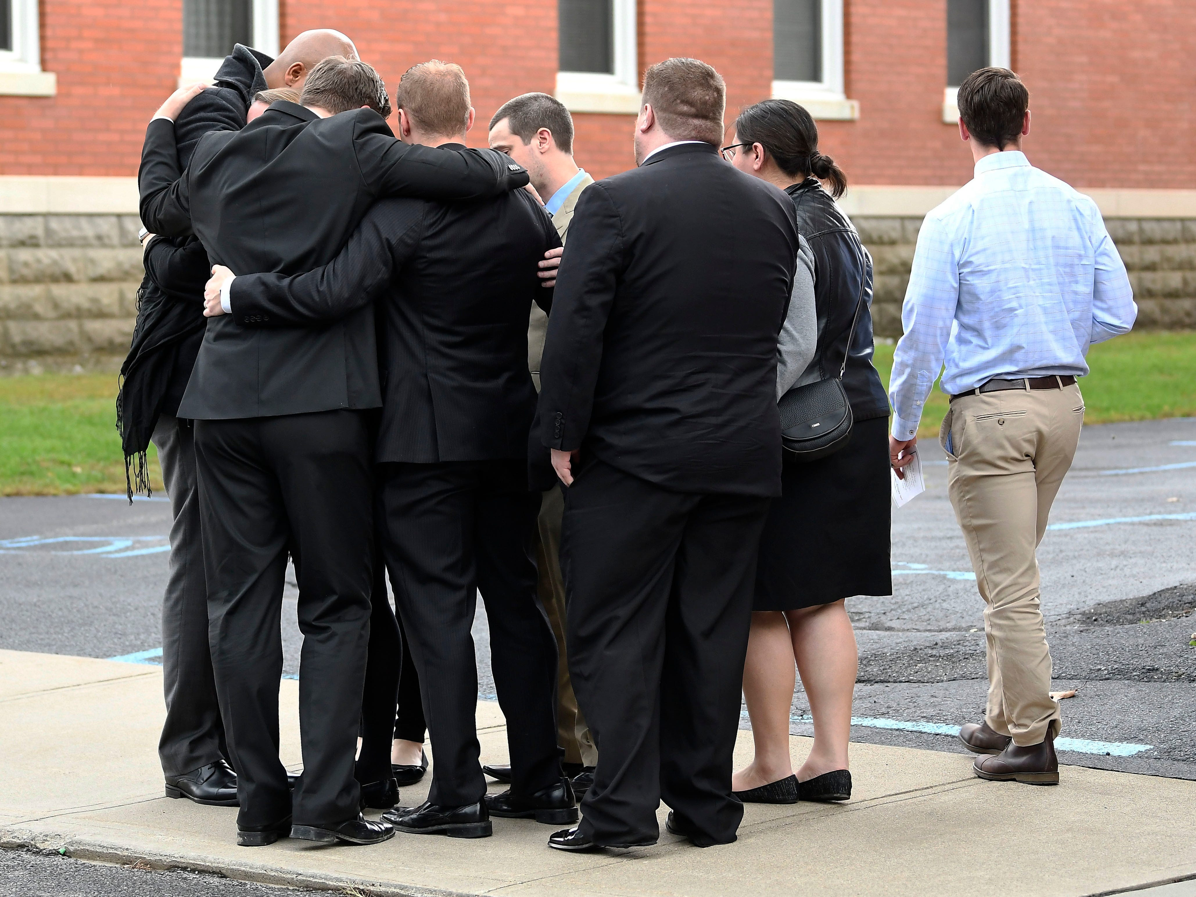 Friends and family arrive for a funeral Mass for eight of the 20 people killed in last Saturday's fatal limousine crash in Schoharie, N.Y., at St. Stanislaus Roman Catholic Church in Amsterdam, N.Y., Saturday, Oct. 13, 2018. (AP Photo/Hans Pennink)