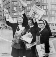 Sept. 23, 1971: Adding a feminine touch for first time to Old Newsboys Day were, (from left) Sister Bryan, principal and Sisters Mary Walter and Barbara, all of Mercy High School. They stood at East Avenue and Main Street.