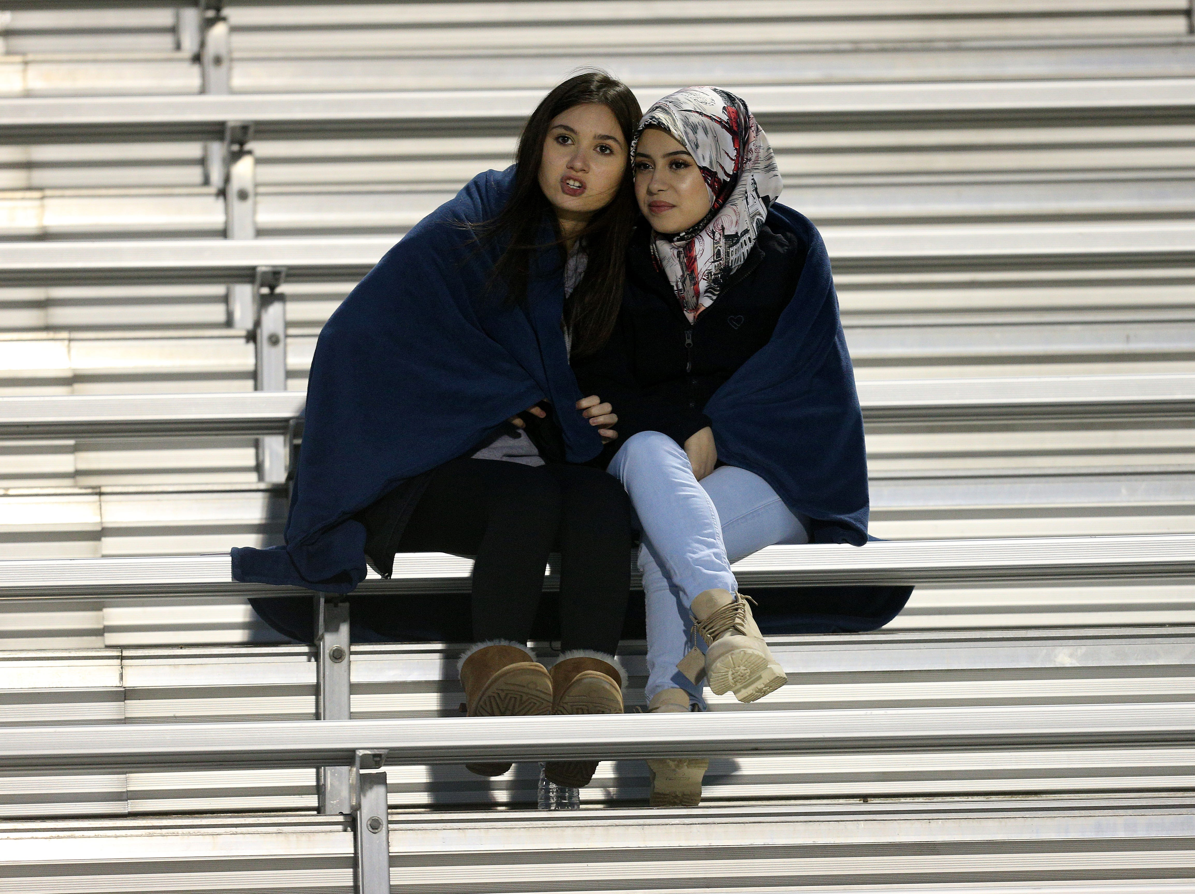 Eastridge fans bundle up on a cold night for high school football as Eastridge beat Arcadia 28-14.