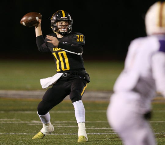 McQuaid's Hunter Walsh looking to connect down field against East.