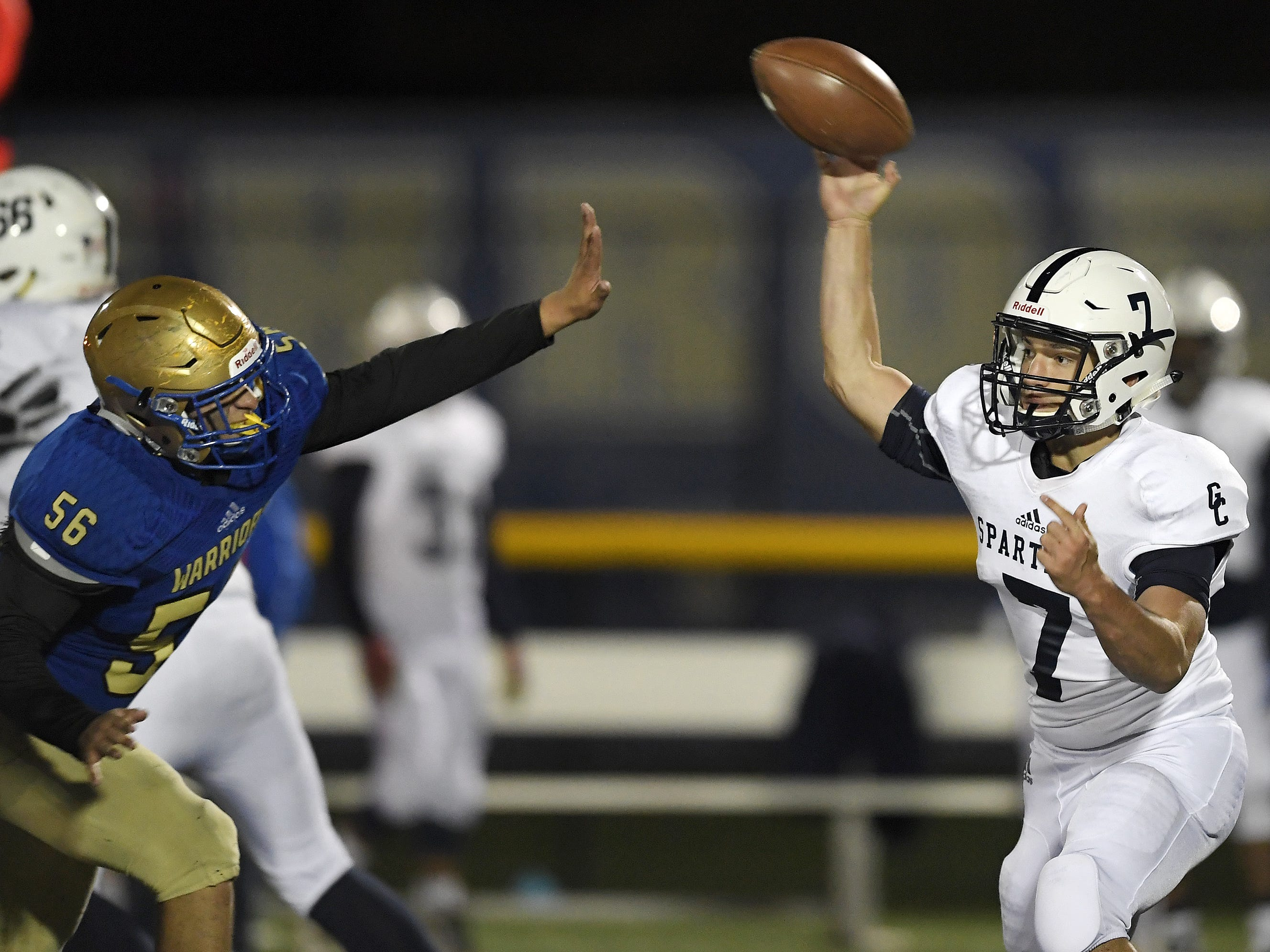 Gates Chili's Jake Antinelli, right, throws a pass while pressured by Webster Schroeder's Giacomo Lo Re during a game played Friday, Oct. 12, 2018 at Webster Schroeder. Webster Schroeder beat Gates Chili 28-7.