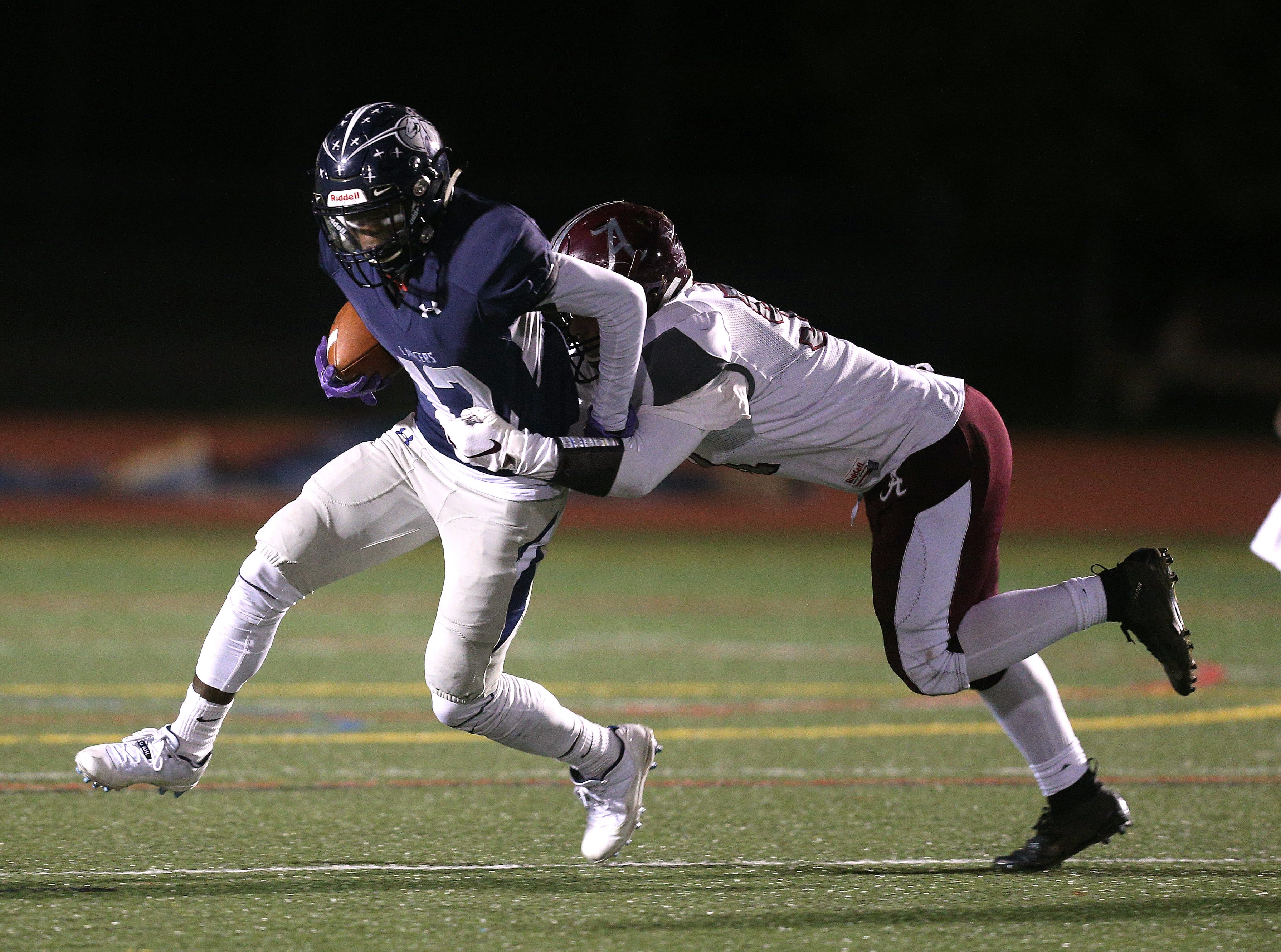 Eastridge's Jalen Rose Hannah is tackled by Arcadia's Alex Testa.