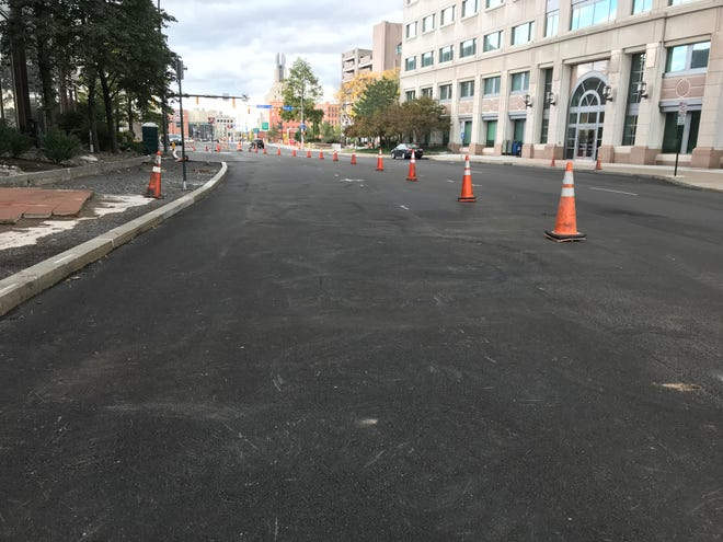 Cones still divide the westbound from the new eastbound lanes on East Broad Street near the intersection of South Clinton Avenue. The road is scheduled to be striped between 9 a.m and 3 p.m. Oct. 18.