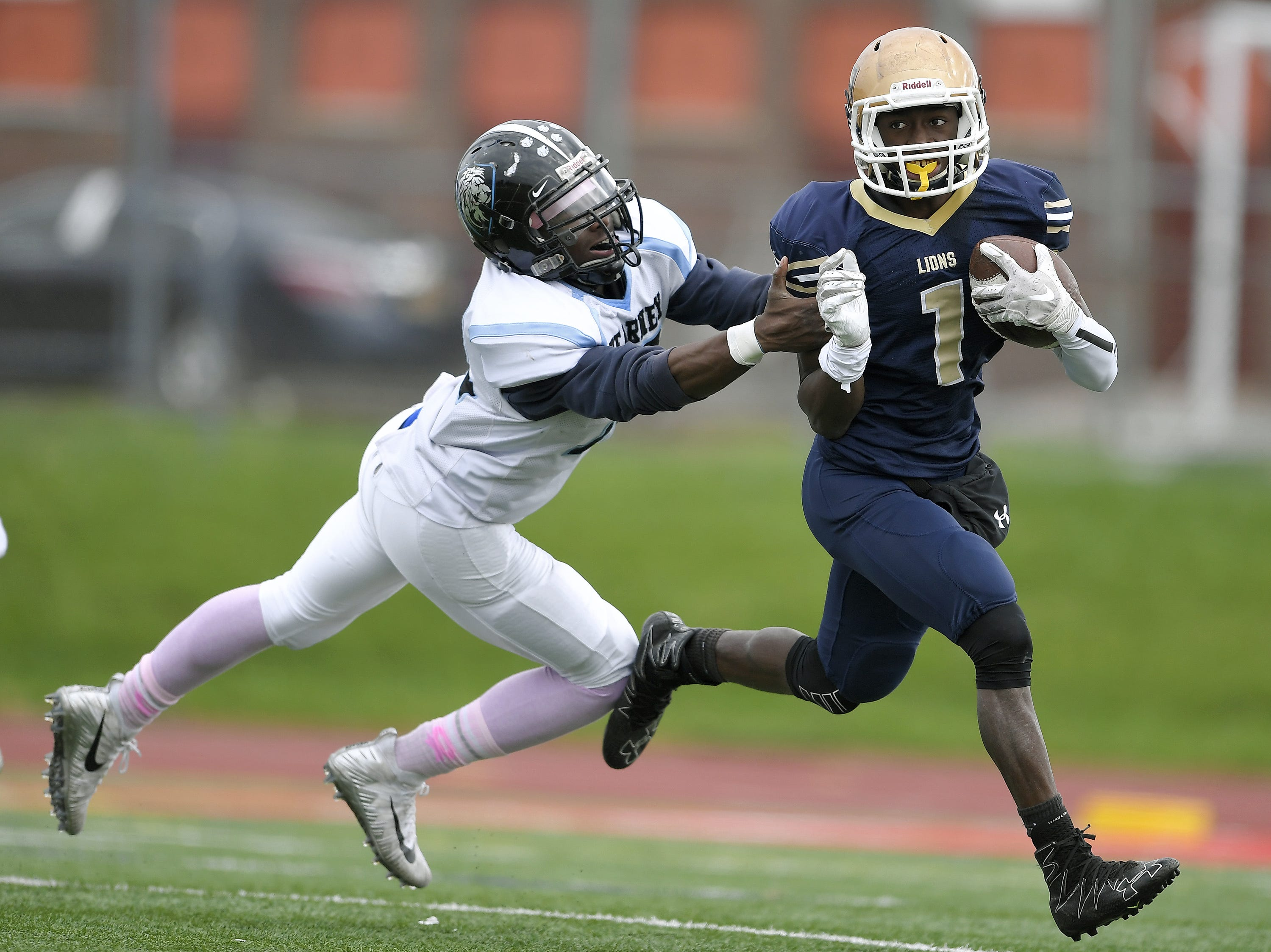 Leadership's Maurice Glenn, right, avoids a tackle by Bishop Kearney's Jawann Perry during a regular season game played at Franklin High School, Saturday, Oct. 13, 2018. Leadership Academy beat Bishop Kearney/Rochester Prep 12-6.