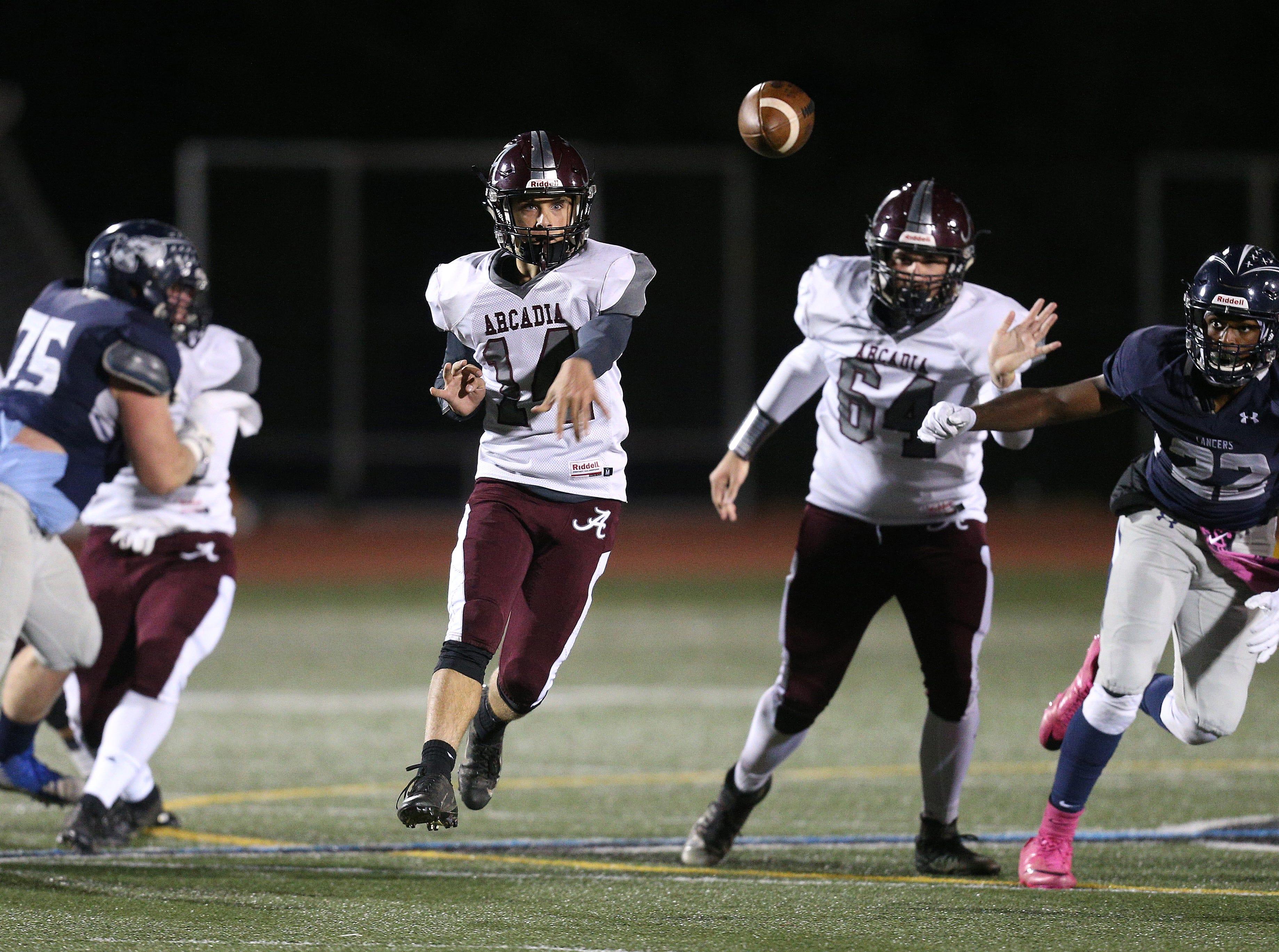Arcadia quarterback Brian Shonitsky throws a short pass.