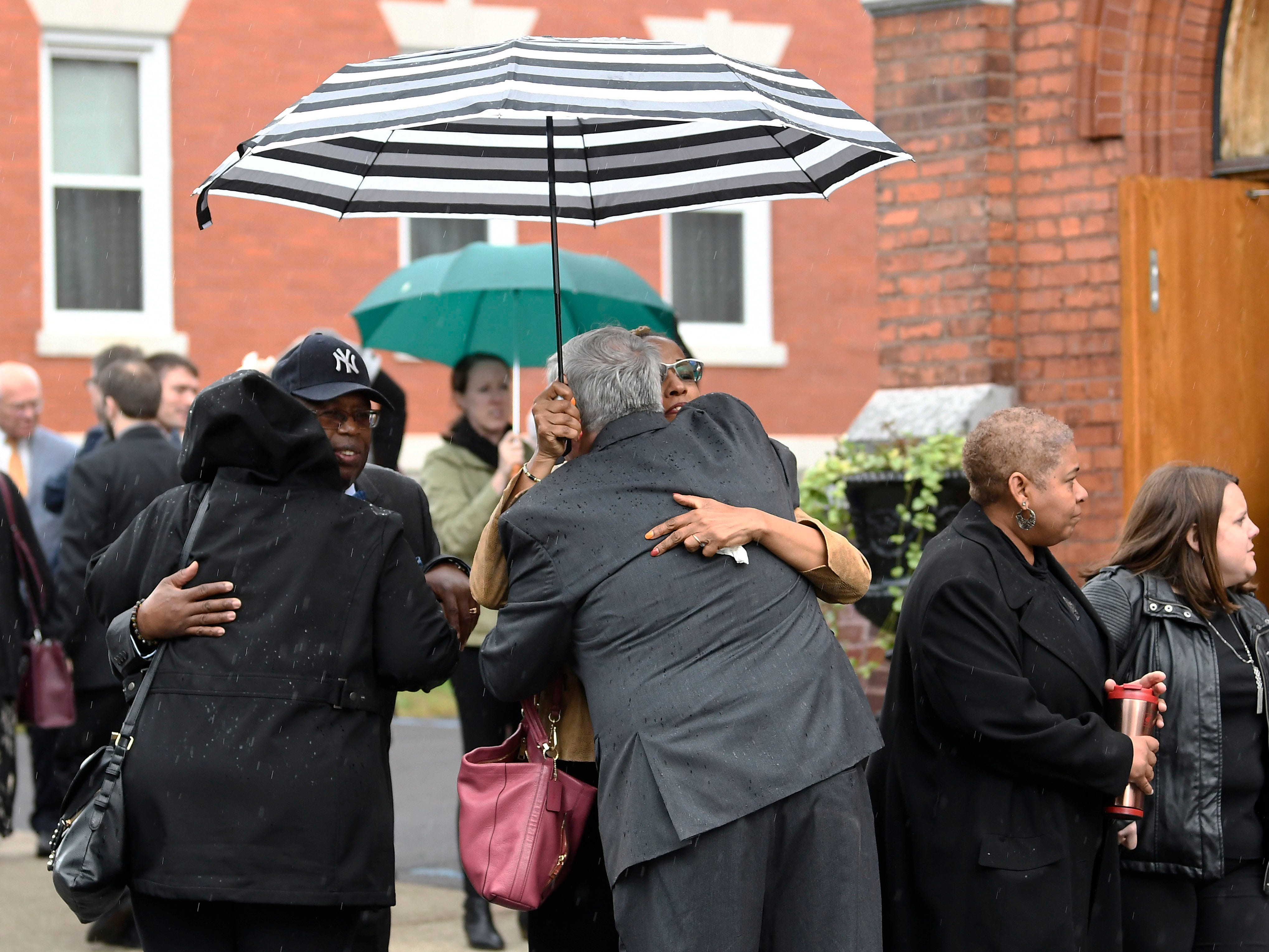 Friends and family arrive for a funeral mass for eight of the 20 people killed in last Saturday's fatal limousine crash in Schoharie, N.Y., during a memorial service at St. Stanislaus Roman Catholic Church in Amsterdam, N.Y., Saturday, Oct. 13, 2018. (AP Photo/Hans Pennink)