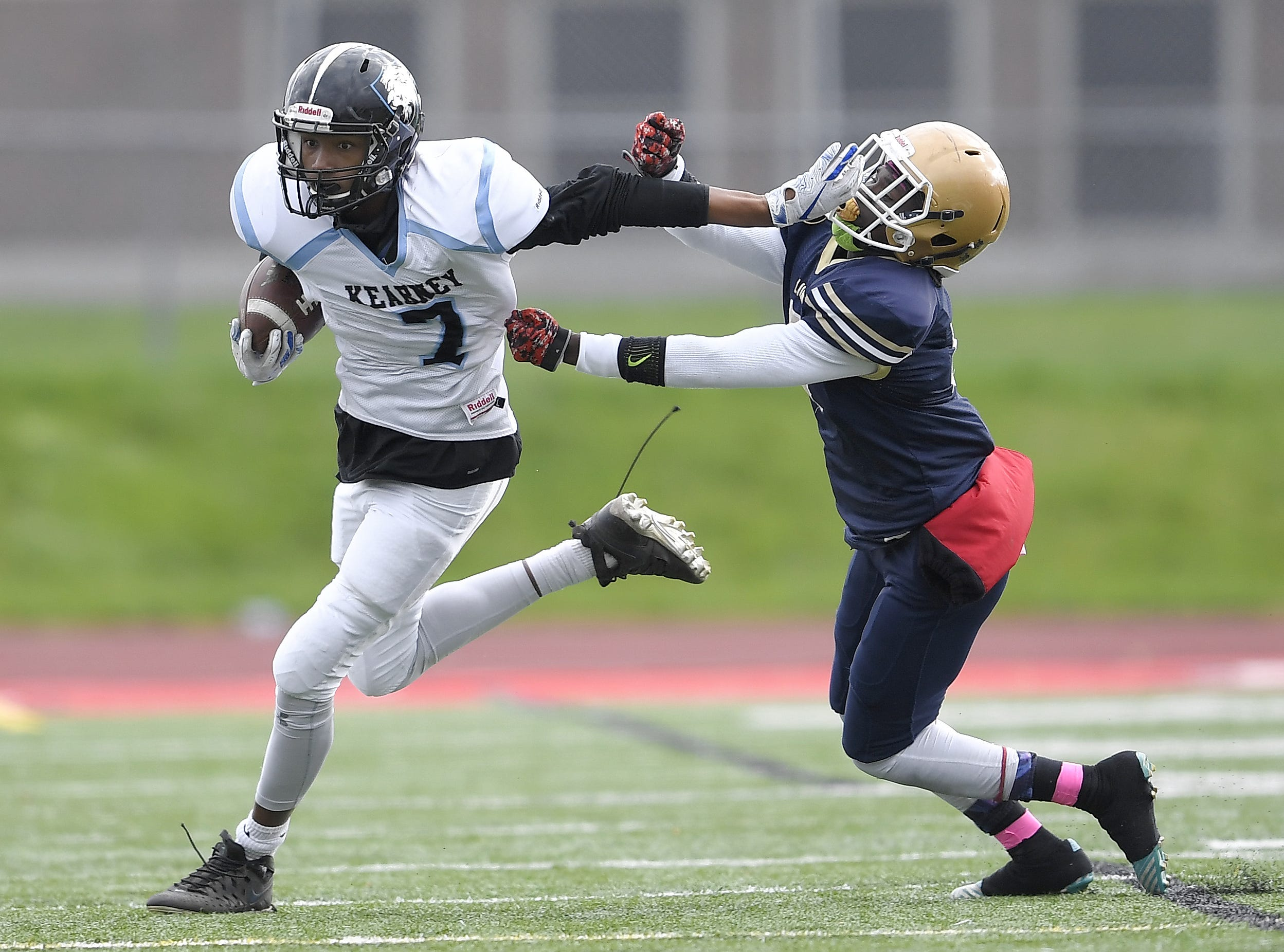 Bishop Kearney's Kidtrell Blocker, left, stiff arms Leadership's Jasun Beckford during a regular season game played at Franklin High School, Saturday, Oct. 13, 2018. Leadership Academy beat Bishop Kearney/Rochester Prep 12-6.