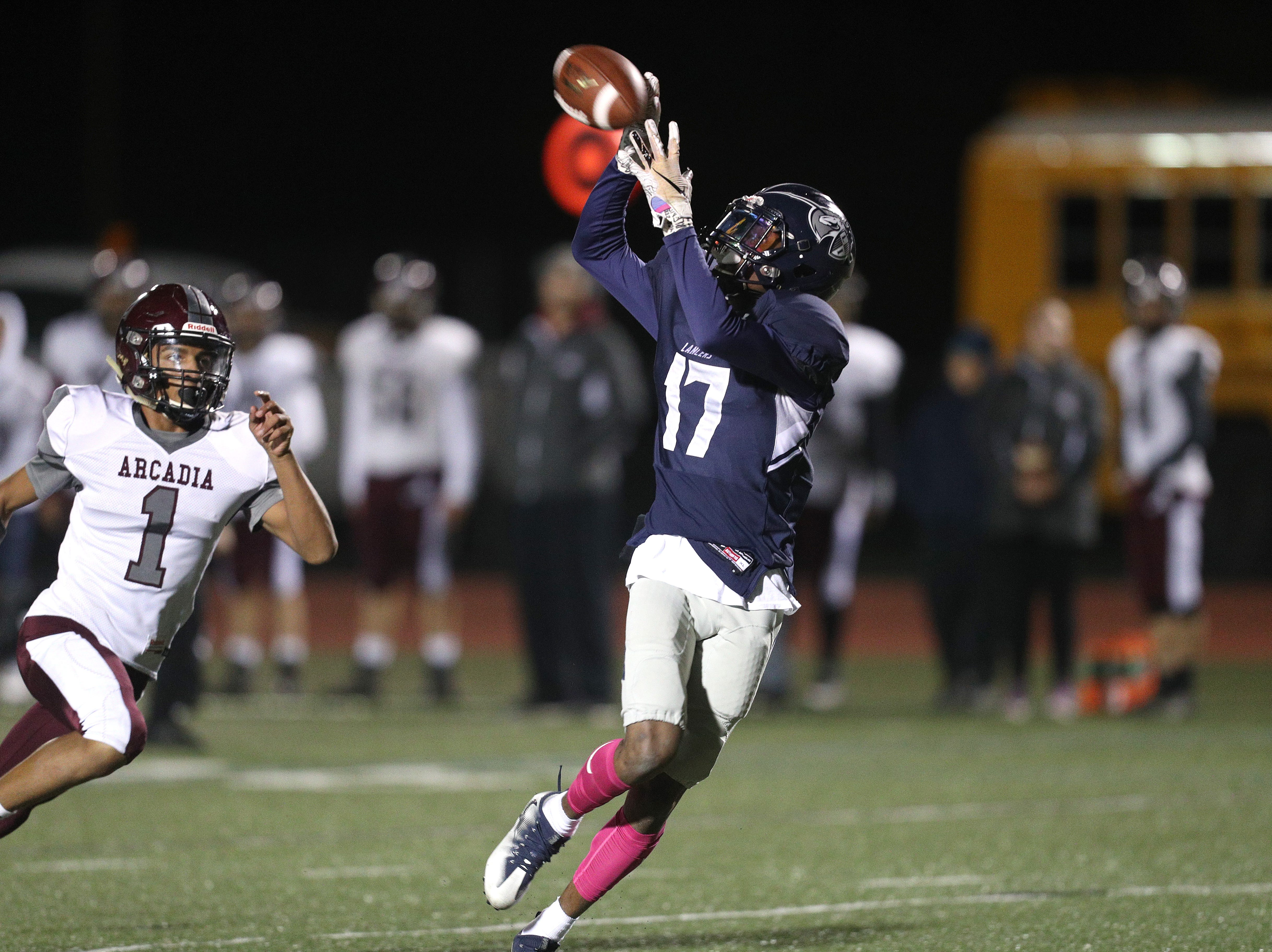 Eastridge receiver Tony Arnold catches a 45-yard touchdown pass behind  Greece Arcadia's Anthony Stephenson in a 28-14 Lancers win.