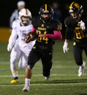 McQuaid's Mark Passero out of the backfield against East.