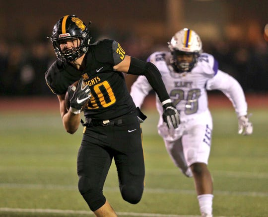 McQuaid's Connor Zamiara heads for the end zone with a touchdown reception in Friday night's game against East.