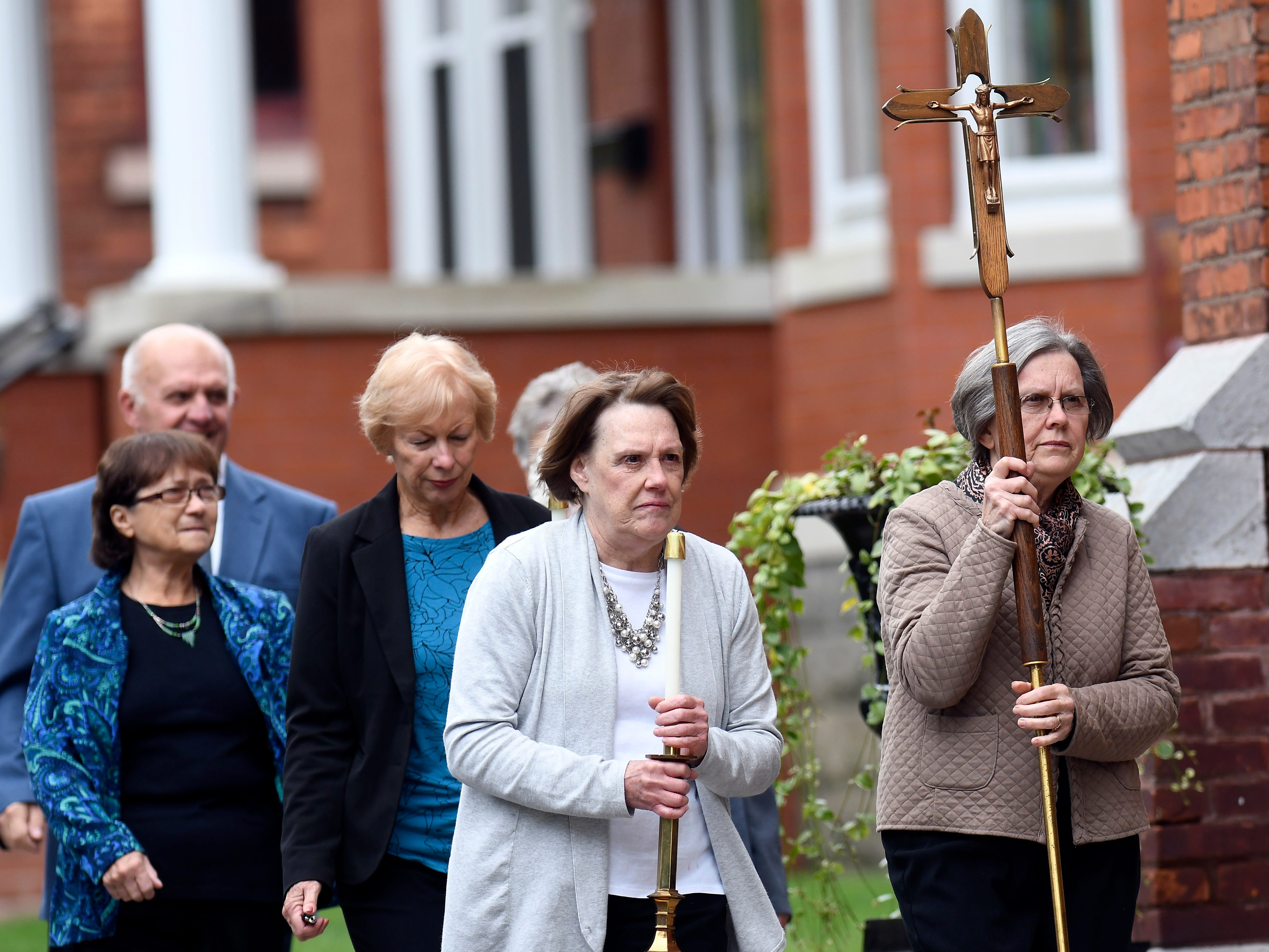 Friends and family arrive before the start of a funeral Mass for eight of the 20 people killed in last Saturday's fatal limousine crash in Schoharie, N.Y., during a memorial service at St. Stanislaus Roman Catholic Church in Amsterdam, N.Y., Saturday, Oct. 13, 2018. (AP Photo/Hans Pennink)