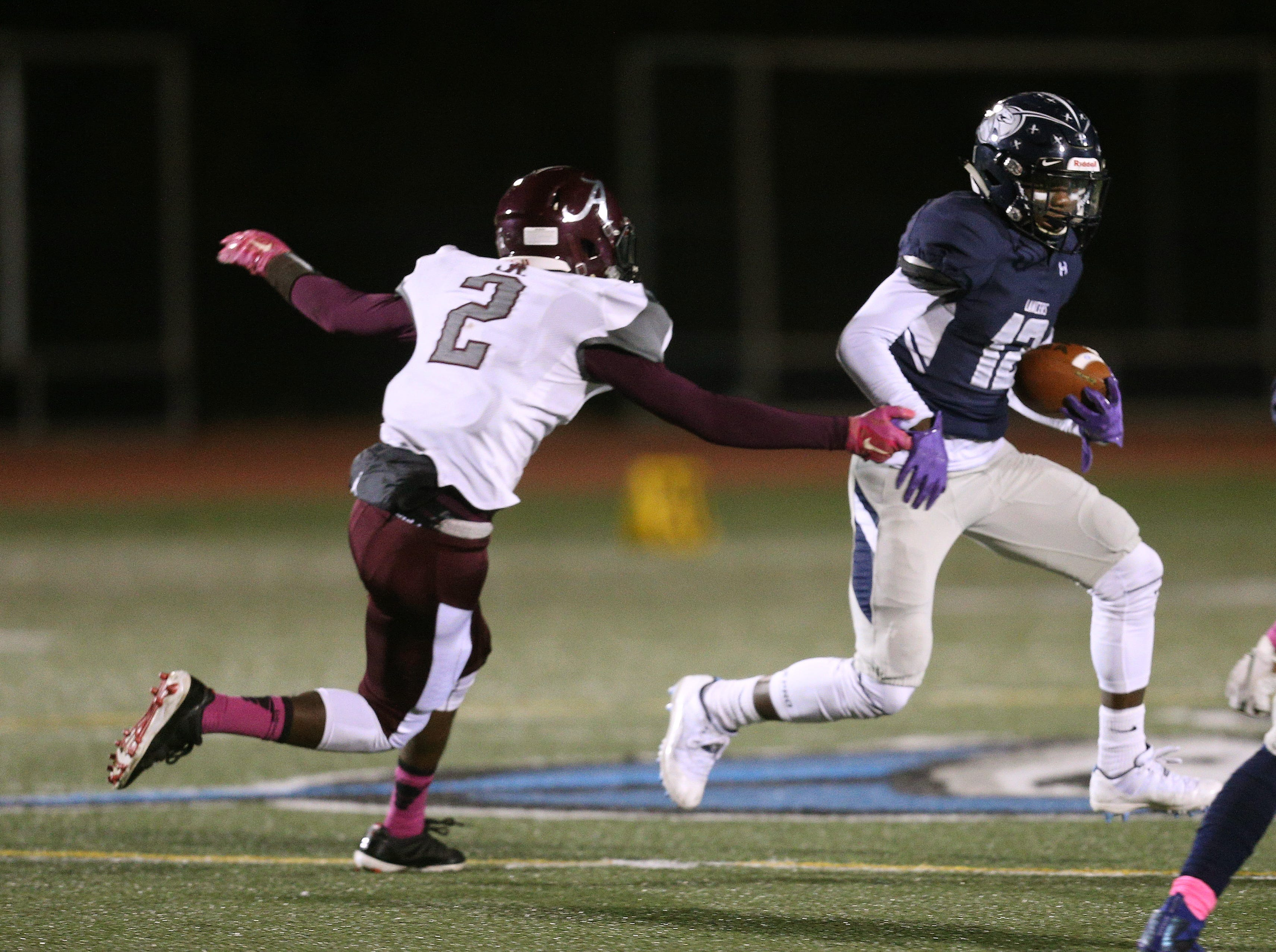 Eastridge's Jalen Rose Hannah tries to get past Arcadia's Aryus Crumity.