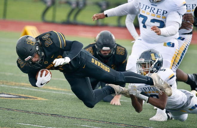 HF-L's Mason Ferrara holds onto the ball while tackled by UPrep's Cassius Facen in the third quarter.