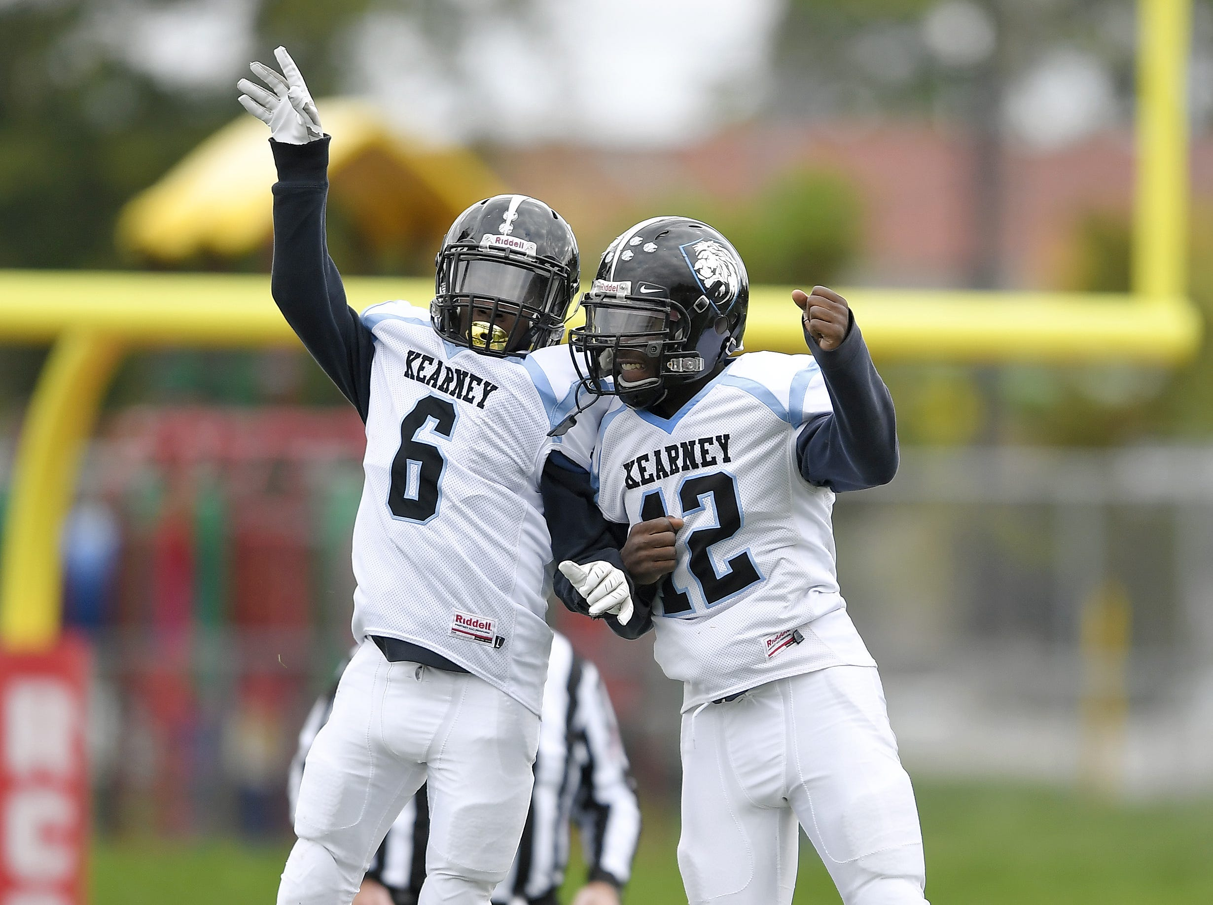 Bishop Kearney's Jami Walker, left, celebrates his inteception with Jawann Perry during a regular season game against Leadership Academy played at Franklin High School, Saturday, Oct. 13, 2018. Leadership Academy beat Bishop Kearney/Rochester Prep 12-6.