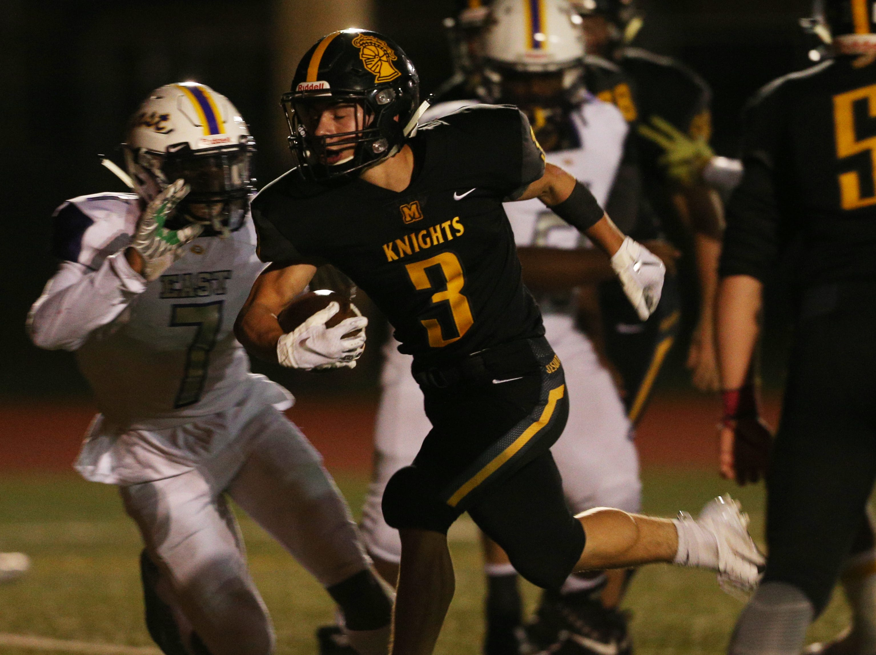 McQuaid's Andrew Passero runs in for a touchdown against East.