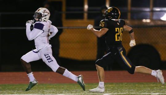 East's Seven McGee runs for a touchdown against McQuaid.