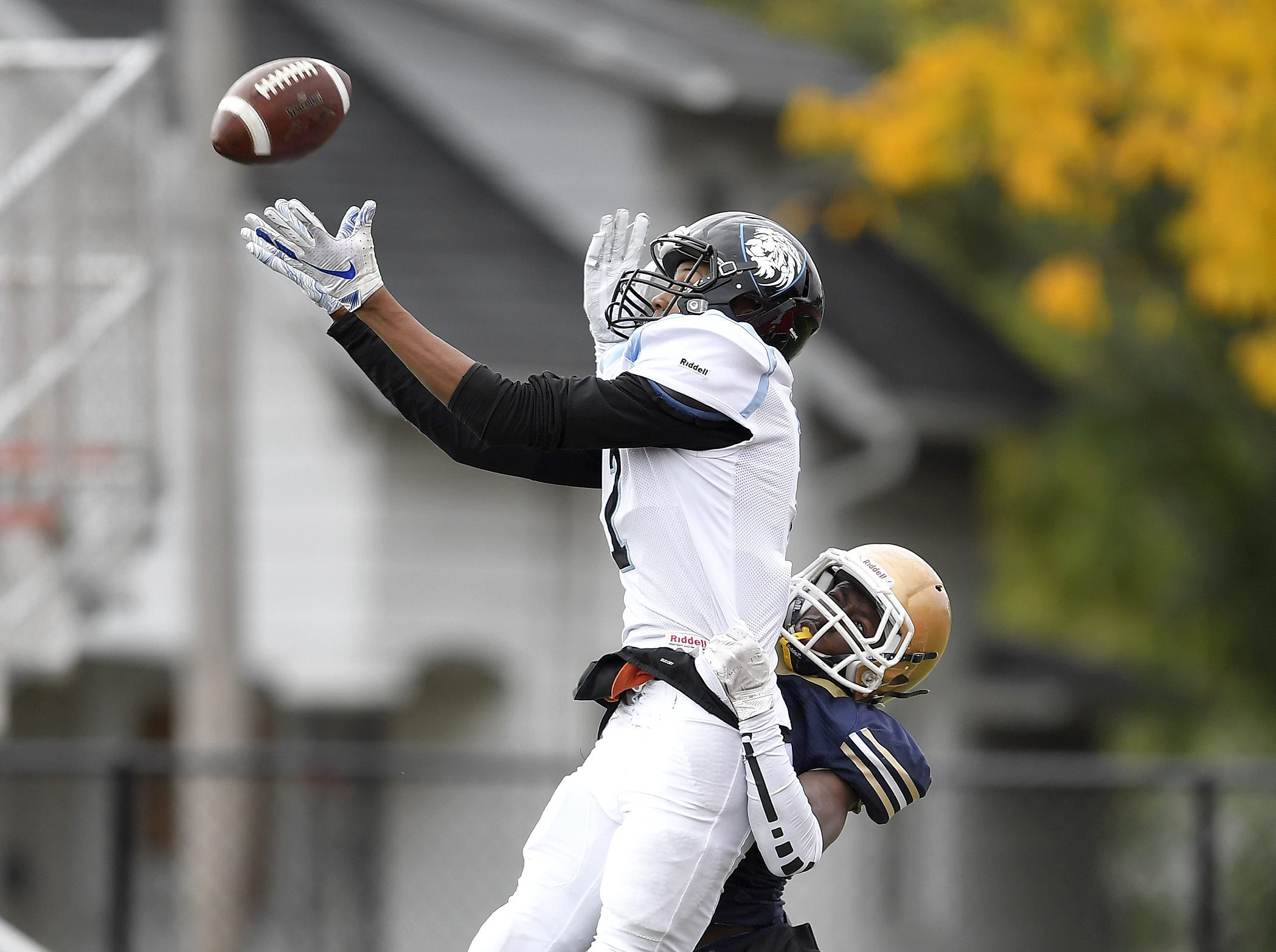 Bishop Kearney's Kidtrell Blocker, left, catches a pass while defended by Leadership's Maurice Glenn during a regular season game played at Franklin High School, Saturday, Oct. 13, 2018. Leadership Academy beat Bishop Kearney/Rochester Prep 12-6.
