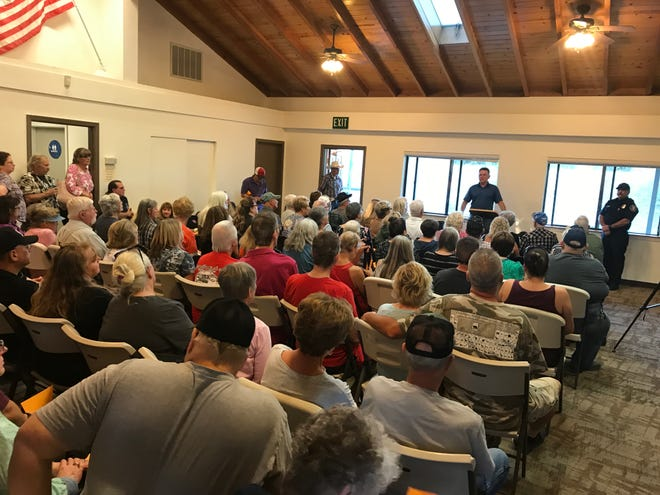 Residents of Cottonwood packed the community center Friday evening for a meeting on the suspected serial arsonist lighting fires in town.