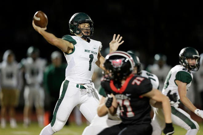 West Salem's Simon Thompson throws a pass during the game on Friday, October 12, 2018, at Mountain View High School in Bend. (Joe Kline/Bulletin photo)