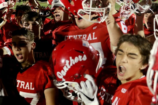 Central players cheer following the North Salem vs. Central football game at Central High School in Independence on Friday, Oct. 12, 2018. Central won the game 27-14.