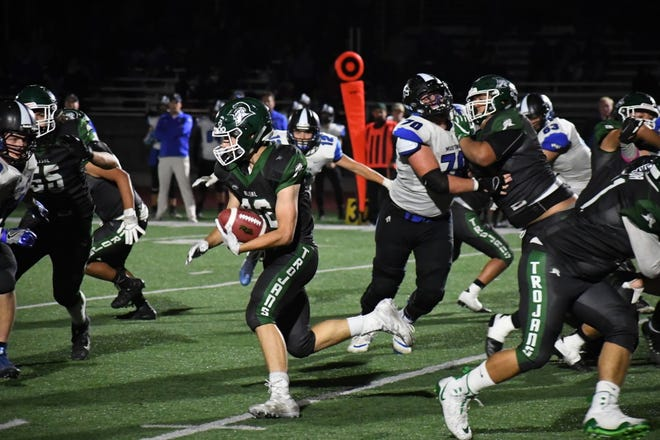 Running back Dorian Segovia (32) scoots between blocks in the fourth quarter.