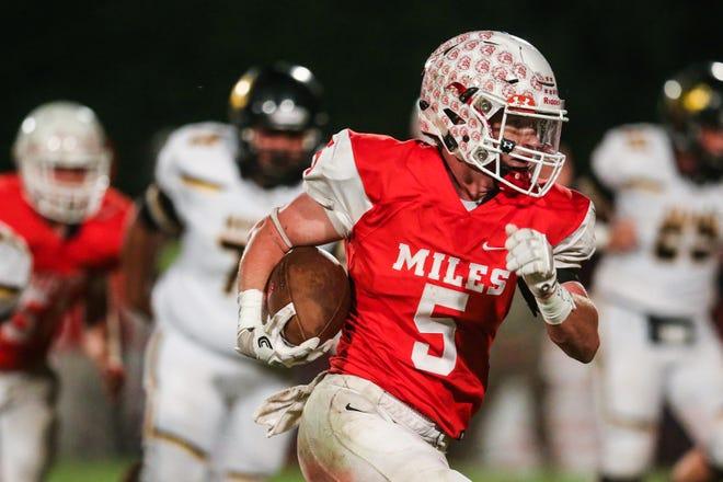 Miles' Mason Bryan runs the ball against Menard on Friday, Oct. 12, 2018, in Miles.
