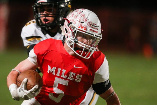 Miles' Mason Bryan runs the ball against Menard Friday, Oct. 12, 2018, at Miles Bulldog Stadium.