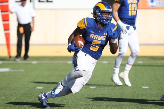 Angelo State University running back Tyrese Nathan picks up some yards during a Lone Star Conference football game against West Texas A&M at LeGrand Stadium at 1st Community Credit Union Field on Saturday, Oct. 13, 2018.