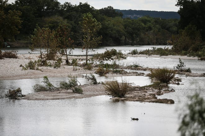 The South Llano River is slowly receding after flooding Saturday, Oct. 13, 2018, in Junction.