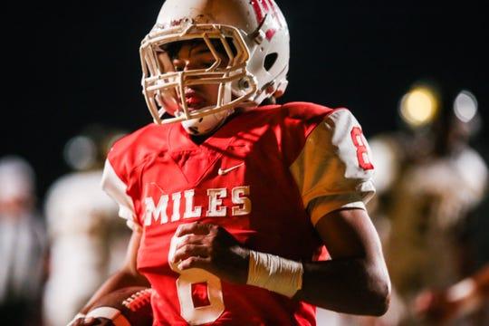 Miles' Jared Flores runs the ball against Menard Friday, Oct. 12, 2018, at Miles Bulldog Stadium.