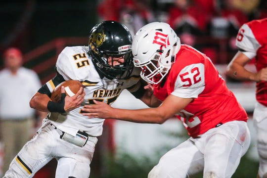 Miles' Joel Garcia tackles Menard's Jasper Salas Friday, Oct. 12, 2018, at Miles Bulldog Stadium.